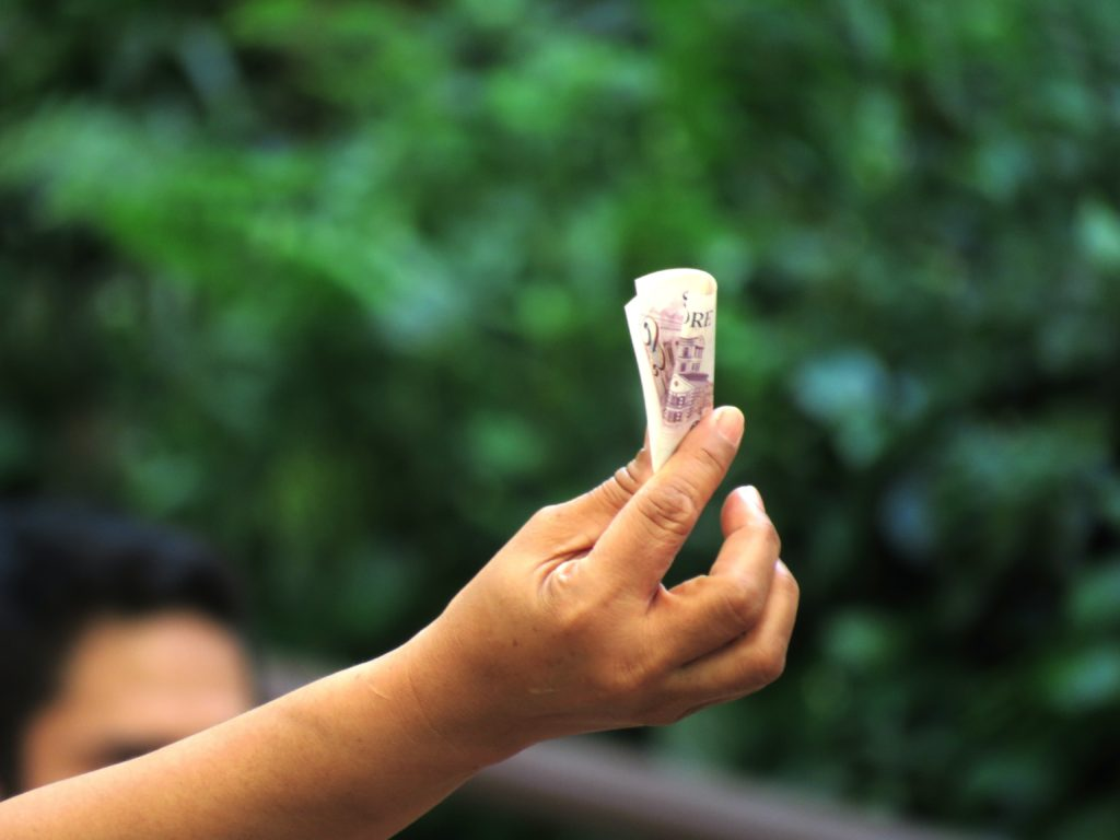 Hand holding Singaporean dollars