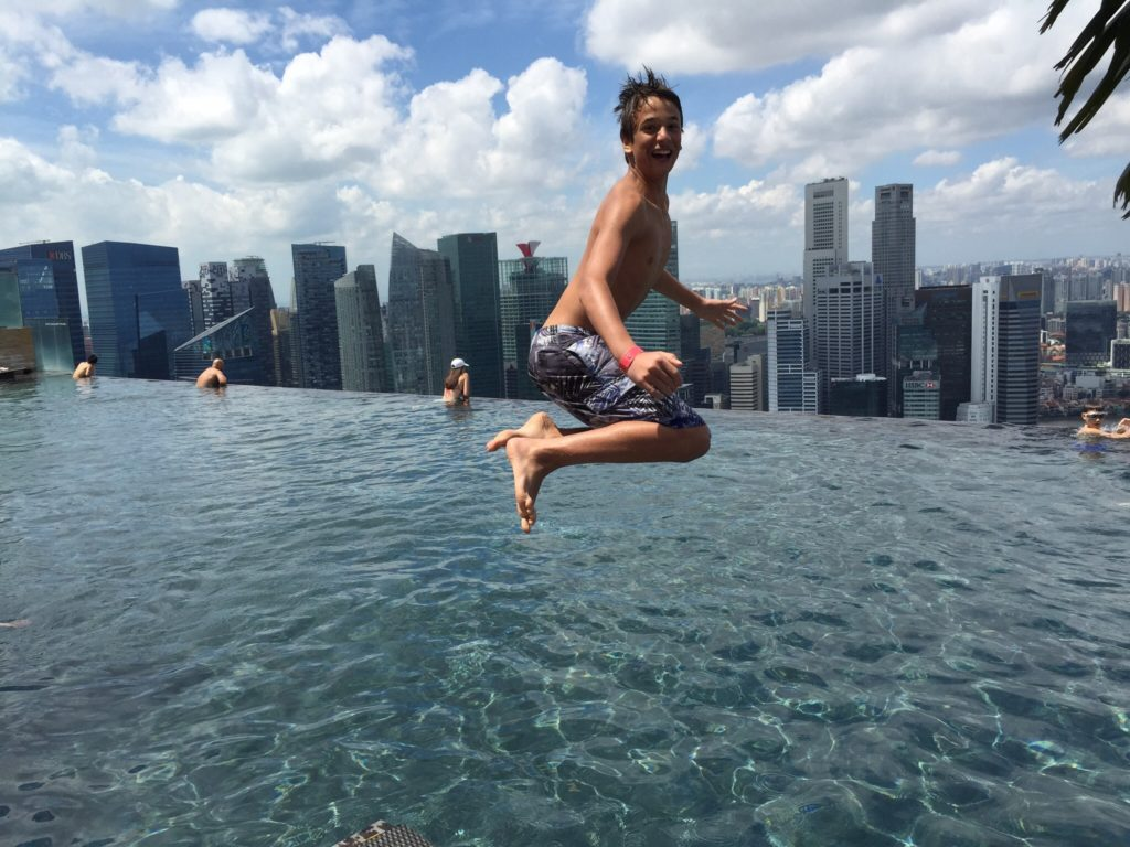 Boy jumping in Marina Bay pool