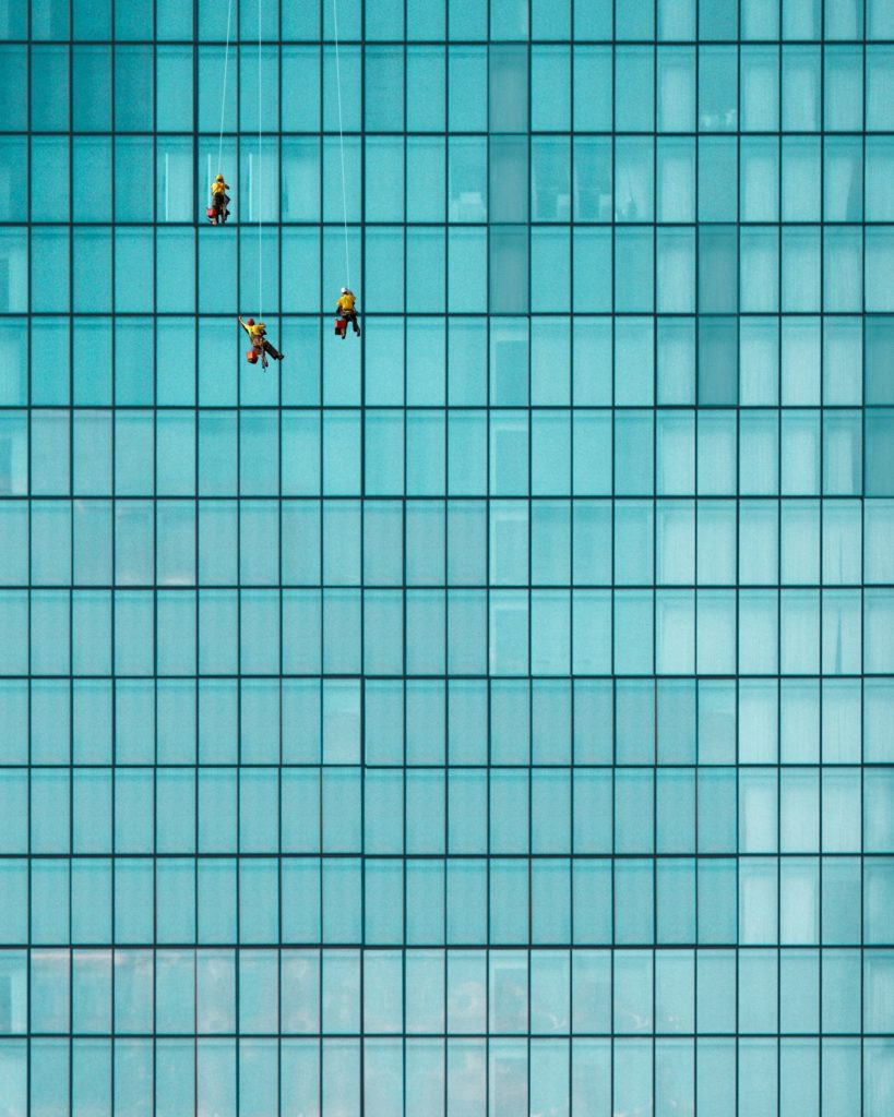Singapore architecture glass wall with cleaners