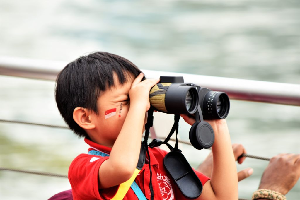 Singaporean boy with binoculars
