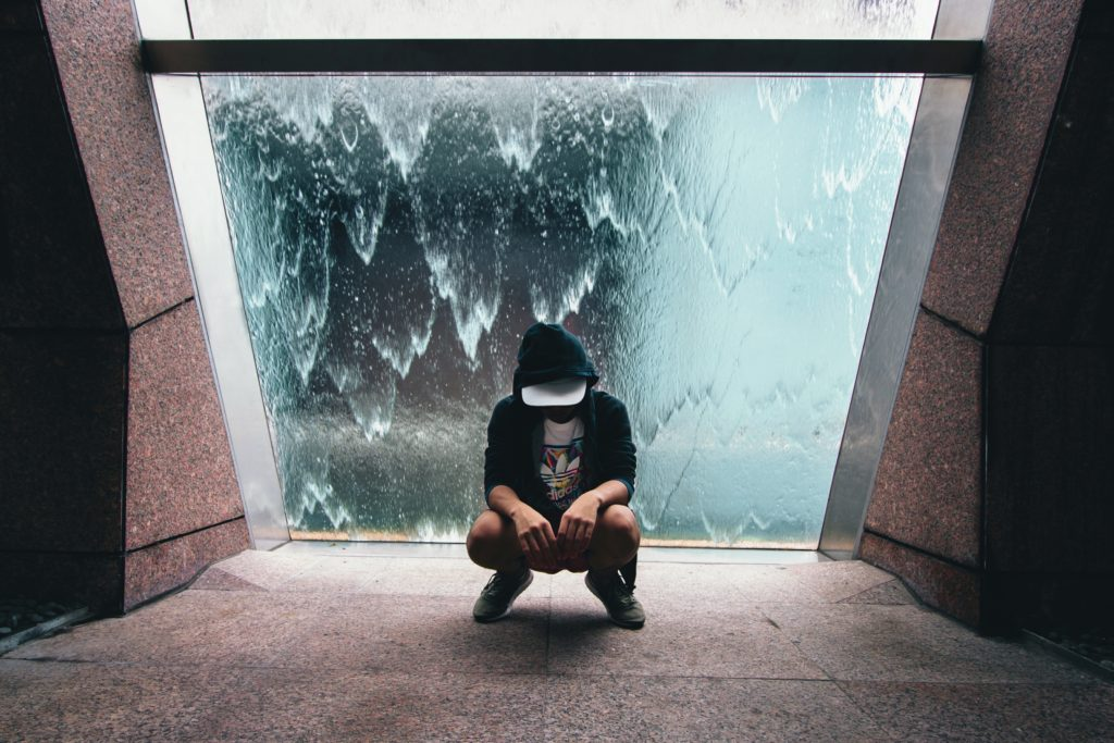 Singaporean guy sitting in front of a window
