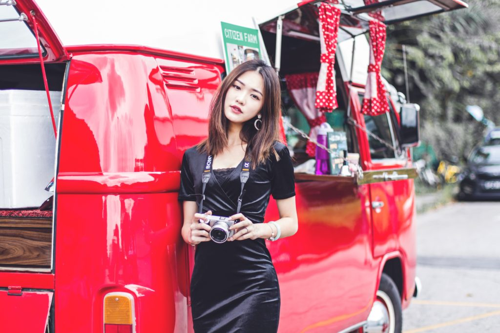 Singaporean woman with red van