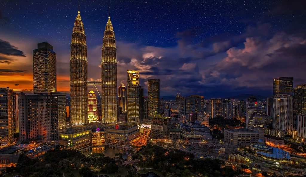 View of Kuala Lumpur with the Petronas towers at dusk