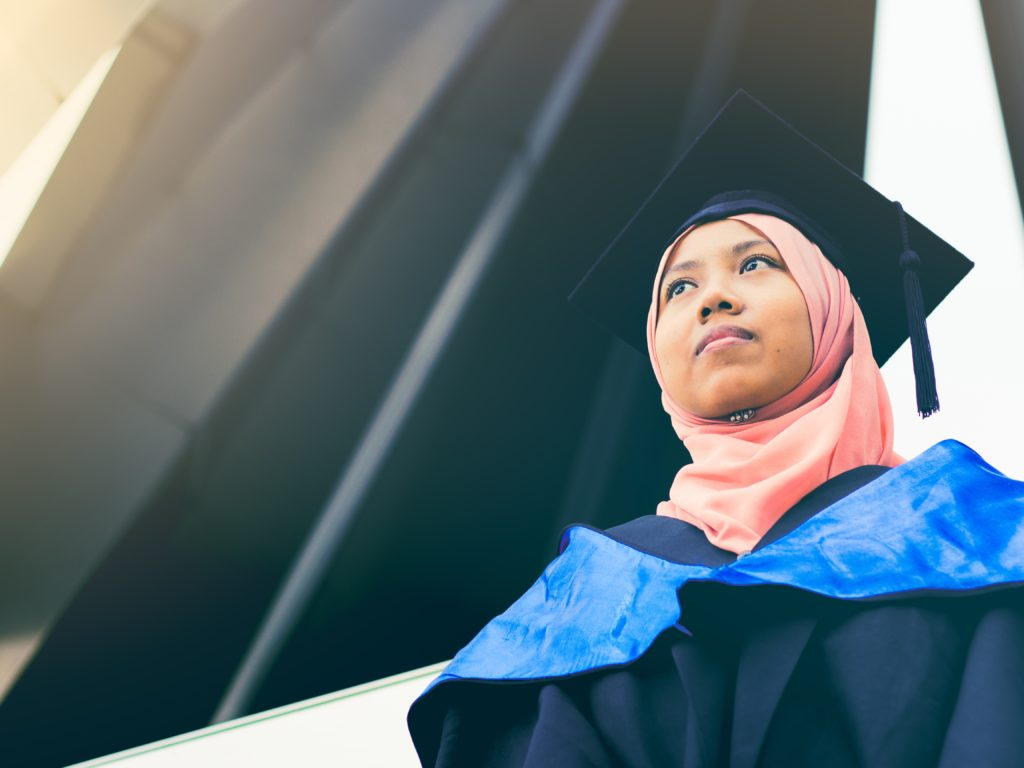 Malaysian Muslim girl with graduation outfit