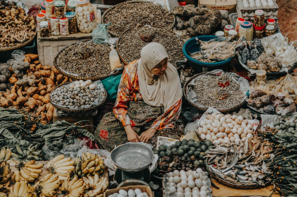 Malaysian Muslim woman selling in a market
