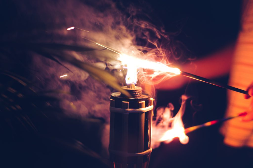 spark lighting an oil lamp