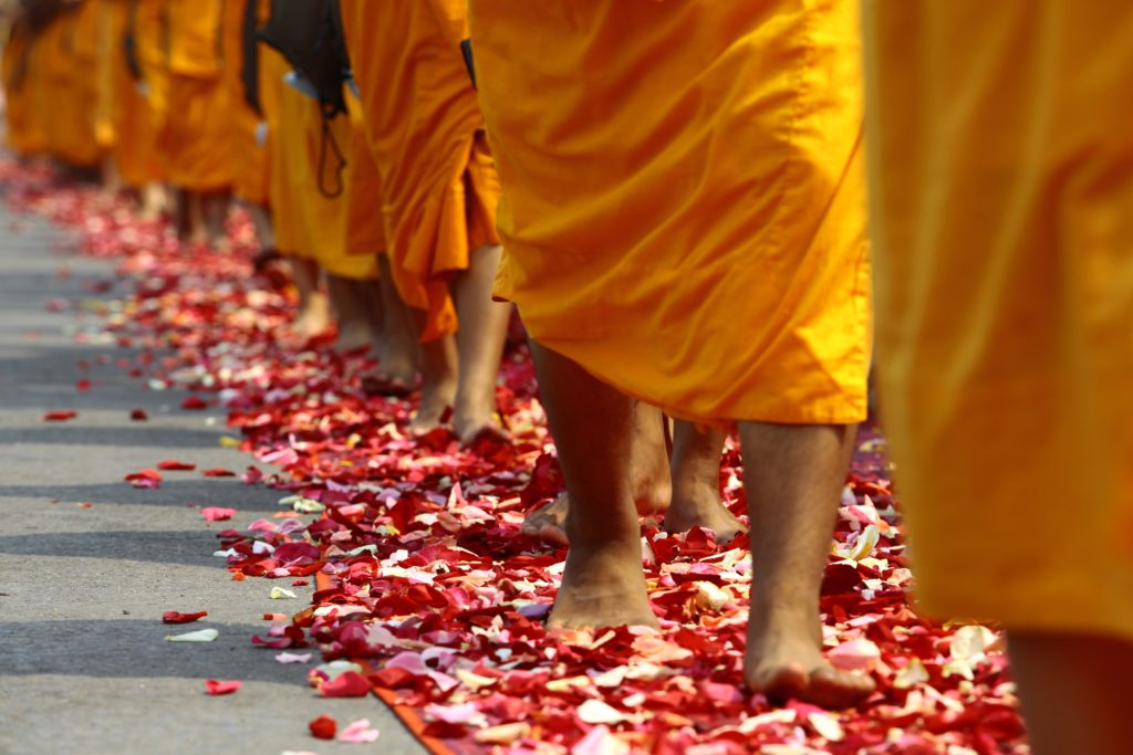 Monks walking on petals